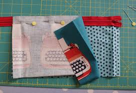 use a zipper foot on sewing machine and sew along top edge of zip through all three layers