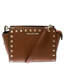 michael michael kors brown leather medium studded selma cross bag nextprev prevnext