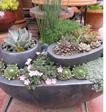 placing pots within pots in order to created a layered garden is a great idea when