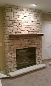 river rock fireplace with a white shabby mantle pastel white bricked stone surround fireplace with brown river rock fireplace with a white