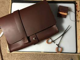 leather handbag made from english chestnut oil tanned leather from springfield leather soft texture with a rich dark color handmade and hand stitched in
