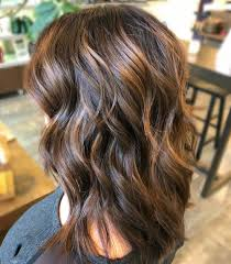 sunkissed caramel halo highlights on dark brown hair
