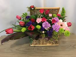 wooden basket with tulipixed flowers