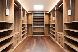 large and biggest wardrobe walk in closet with minimalist drawer and best lighting and furniture decor