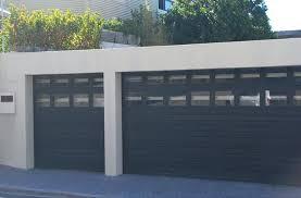 double garage door and single aluminium sectional overhead doors with window panels charcoal horizontal slats screen double garage door