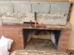 around the hearth we re using steel studs and elsewhere wood to frame the wall you can see extra framing where we ll later mount the big screen tv