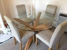 glass dining table with oak legs round glass top cross oak leg dining table in expired