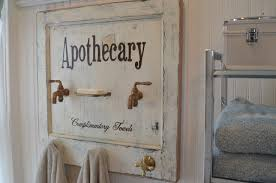 apothecary bath towel rack made from a vine door