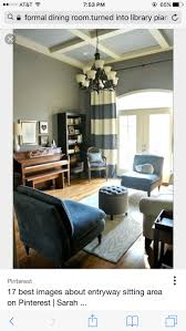 e-design before + after: formal dining room turned into a library/music room  Love the navy and white stripe curtains