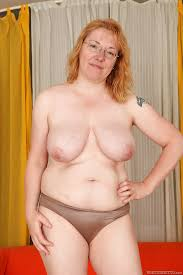 Mature red head naked
