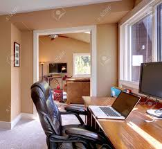 Office Living Room Home Office And Computer And Chair With Brown Walls And Tv In
