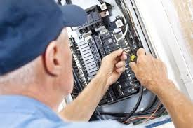 how to the electrical service size of your home man servicing main breaker panel