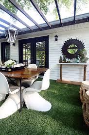 a low maintenance artificial grass covering on a backyard deck