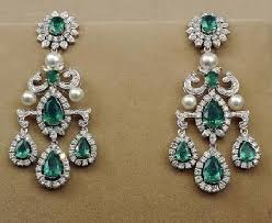 checkout tanishq gorgeous diamond emerald and south sea pearl chandelier earrings