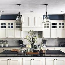 dream range hood for cape white kitchen black countertops cupboards with dark