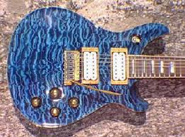 Quilted Maple - Ed Roman Guitars & This 7 string Quicksilver Guitar was built in my Custom Shop in 1998/99.  The upper horn has since been extended for better balance Adamdwight.com