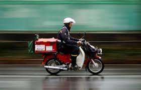 inc shops abroad to duck bleak domestic prospects the a post employee rides a motorcycle in tokyo on feb 18 shrinking