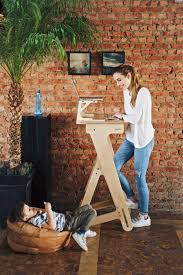 genius standing desk made out of wood and it is super easily height adjule perfect for working ergonomically from home