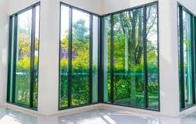 glass house windows. Exellent House Glass Window Overlooking Green Garden  On House Windows