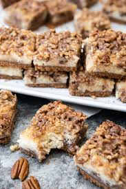 pecan pie cheesecake bars.  Pecan Pecan Pie And Classic Cheesecake With A Graham Cracker Crust Meet In  Handheld Deliciously Layered Throughout Pie Cheesecake Bars C