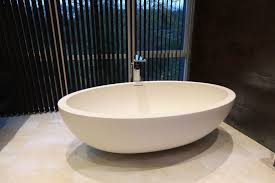 interior oval white porcelain freestanding bathtub using waterfall faucet stande bath with shower sizes bathtubs philippines