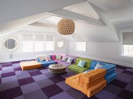 Colorful Kids Attic Media Room With Sectional Sofa and Throw Pillows