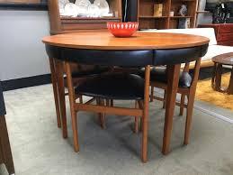 danish teak round table with nesting chairs