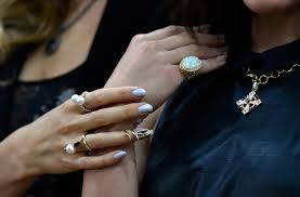 models display pieces of jewelry during a panel discussion of new trends at the jck las