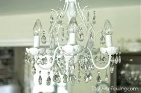 the crystal chandeliers light up the paintings weeks who sang