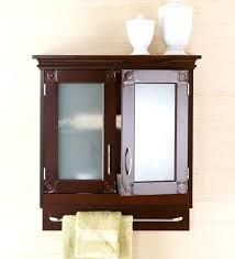 bathroom wall cabinet with towel bar two small white ceramic jars on frosted glass door modern bathroom wall cabinet