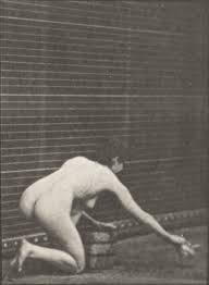 Naked woman scrubbing floor