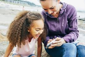 little and mom looking at phone joke