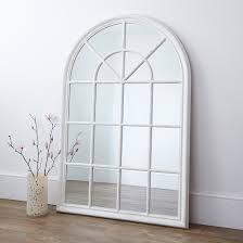 large arched wooden window wall mirror with a painted white distressed frame