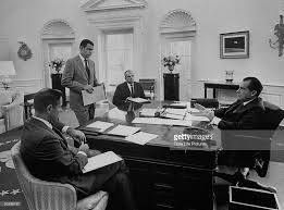nixon oval office. Dick Nixon (R) Sitting At His WH Oval Office Desk Mtg. D