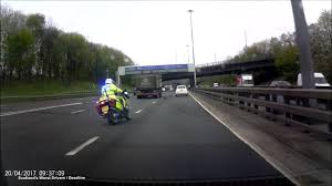 Fast Lane Light And Sound Police Motorcycle Car Narrowly Misses Police Bike As It Swerves Into Fast Lane