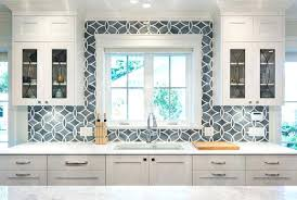 white kitchen with blue gray tile backsplash