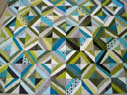 Gambrels of the Sky & By the time I got to Zanni and Frank's quilt, I started making the squares  even more off kilter by using fabric strips with steeper angles. Adamdwight.com