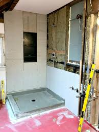the entire back wall is cement board har which is because we re not just tiling the shower but the whole dang wall behind the vanity toilet