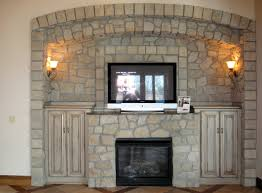 Stone fireplace with side cabinets | Stone Fireplaces | Pinterest ...
