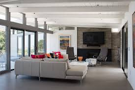 view in gallery throw pillows add color to the neutral living room 1950s mid century modern home remodeled into add midcentury modern style