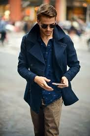 opt for a deep blue pea coat and camel chino pants for a dapper casual get navy