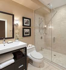 Remodeled bathroom with glass shower and updated vanity