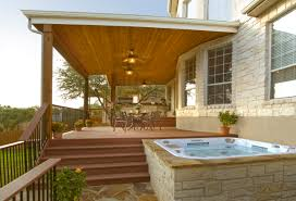 covered deck patio with lower level hot tub