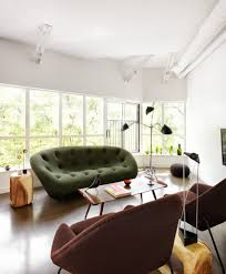 bachelor pad furniture. Gorgeous Womb Chair Mode Other Metro Contemporary Living Room Decorating Ideas With Bachelor Pad Brown Armchair Green Sofa Loft Wall Of Windows Wood Side Furniture
