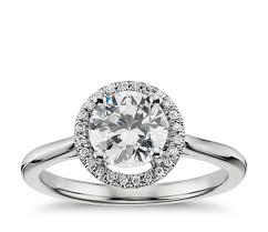 plain shank floating halo engagement ring in 14k white gold blue