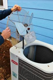 remove the fan cage to gain access to the interior of the condensor unit