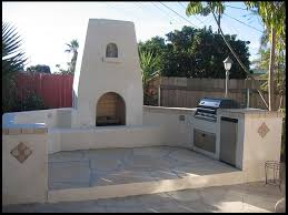 custom masonry stucco outdoor bbq island and fireplace