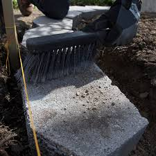 brush dirt off of the blocks after installing