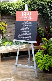 give guests a taste of the meal to e with a diy restaurant style menu board that rests on a sy easel