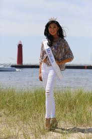 Asian girl representing Michigan for Miss America is being called.